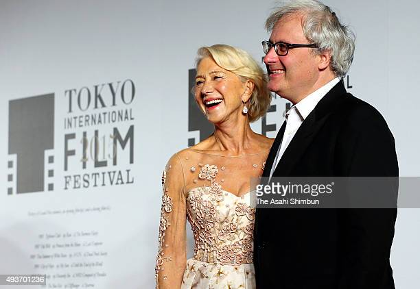 Actress Helen Mirren and director Simon Curtis pose for photographs during the opening ceremony of the Tokyo International Film Festival at Roppongi...