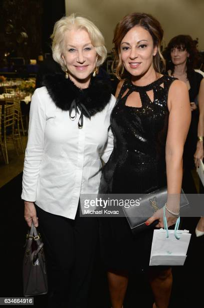 Actress Helen Mirren and Michele Tebbe attend MusiCares Person of the Year honoring Tom Petty at the Los Angeles Convention Center on February 10...