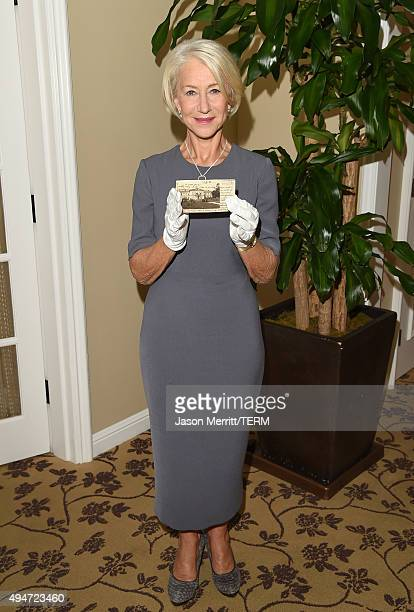 Actress Helen Mirren holds an original postcard now on exhibit at the Los Angeles Museum of the Holocaust on October 282015 in Los Angeles California...