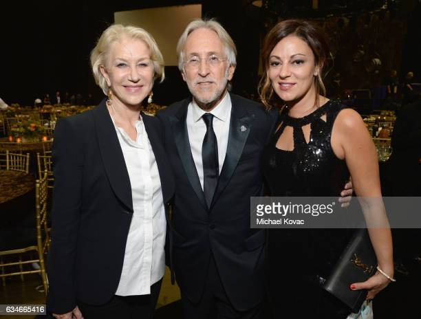 Actress Helen Mirren President/CEO of MusiCares and The Recording Academy Neil Portnow and Michele Tebbe attend MusiCares Person of the Year honoring...