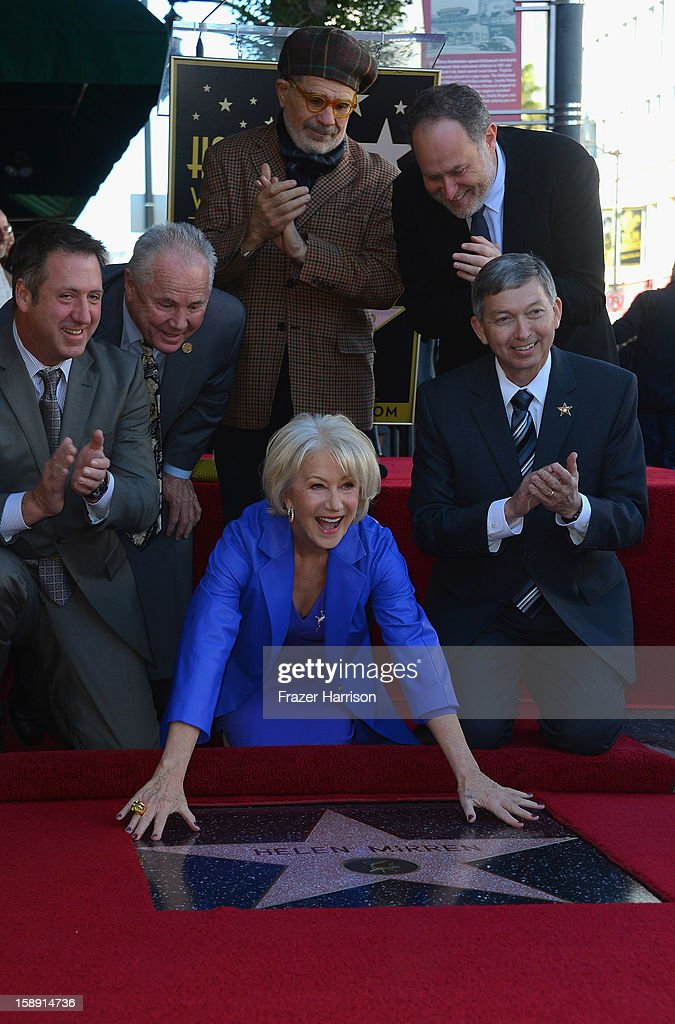 Actress <a gi-track='captionPersonalityLinkClicked' href=/galleries/search?phrase=Helen+Mirren&family=editorial&specificpeople=201576 ng-click='$event.stopPropagation()'>Helen Mirren</a>, unveils her star on the Hollywood walk of Fame watched on by guest speakers on January 3, 2013 in Hollywood, California.