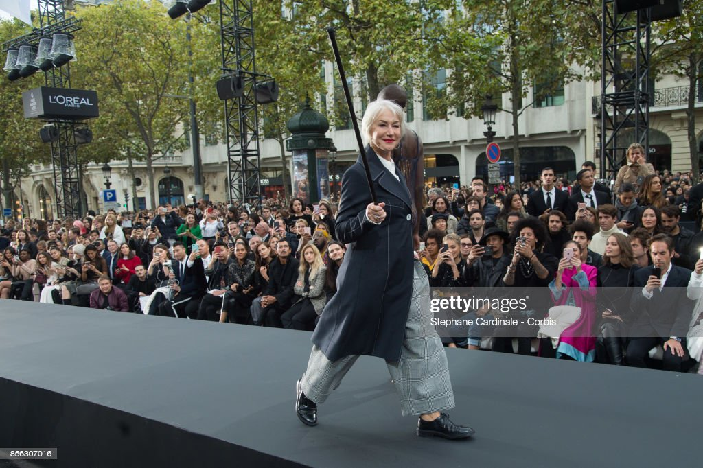 Actress Helen Mirren walks the runway during the Le Defile L'Oreal Paris Spring Summer 2018 show as part of Paris Fashion Week at Avenue des Champs-Elysees on October 1, 2017 in Paris, France.