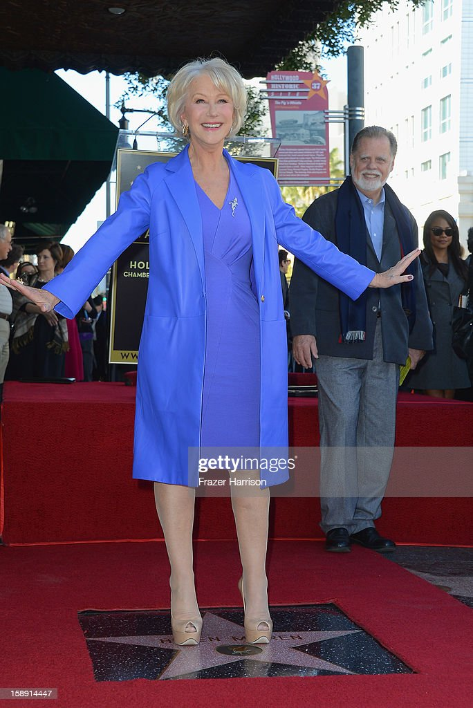 Actress <a gi-track='captionPersonalityLinkClicked' href=/galleries/search?phrase=Helen+Mirren&family=editorial&specificpeople=201576 ng-click='$event.stopPropagation()'>Helen Mirren</a>, watched on by husband director Taylor Hackford who Honored On The Hollywood Walk Of Fame with her own star on January 3, 2013 in Hollywood, California.