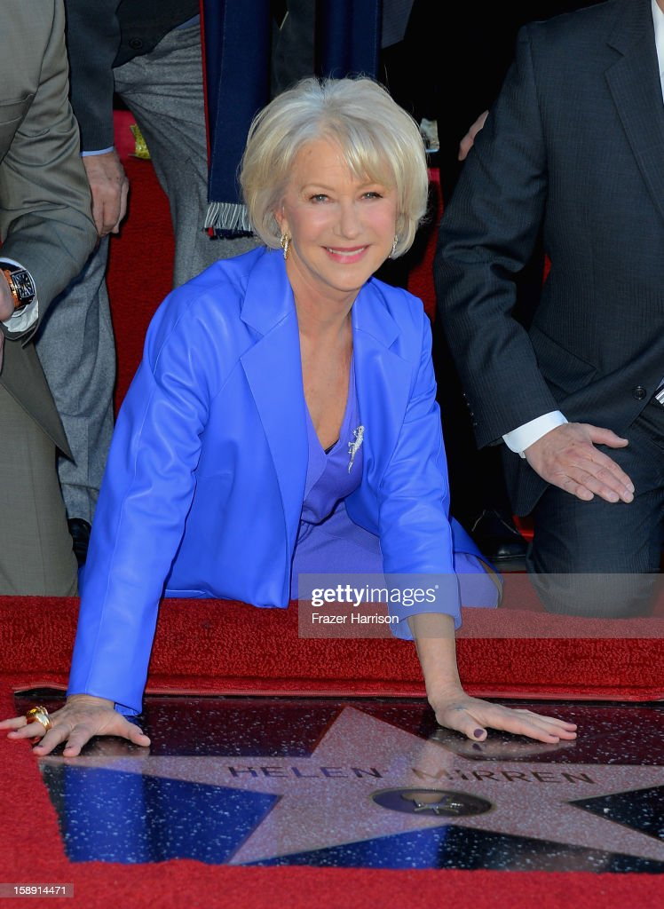 Actress <a gi-track='captionPersonalityLinkClicked' href=/galleries/search?phrase=Helen+Mirren&family=editorial&specificpeople=201576 ng-click='$event.stopPropagation()'>Helen Mirren</a>,who Honored On The Hollywood Walk Of Fame with her own star on January 3, 2013 in Hollywood, California.