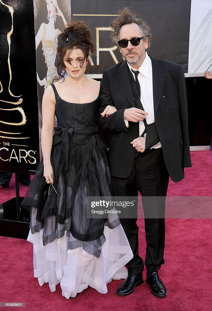 Actress Helena Bonham Carter and director Tim Burton arrive at the Oscars at Hollywood & Highland Center on February 24, 2013 in Hollywood, California.