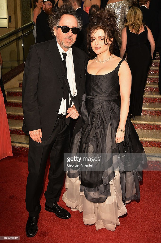 Actress Helena Bonham Carter and director Tim Burton arrives at the Oscars at Hollywood & Highland Center on February 24, 2013 in Hollywood, California.