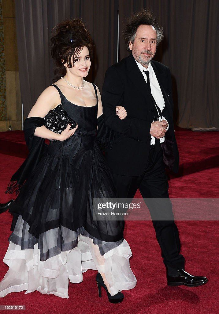 Actress Helena Bonham Carter and director Tim Burton depart the Oscars at Hollywood Highland Center on February 24 2013 in Hollywood California