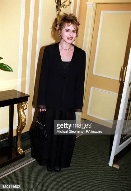 Actress Helena Bonham Carter who received the British Actress of the Year award for her role in 'The Wings of the Dove' at the 1998 London Film...