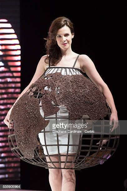 Actress Helena Soubeyrand walks the runway and wears 'Constellation' a chocolate dress made by designer ChristopheAlexandre Docquin and chocolate...