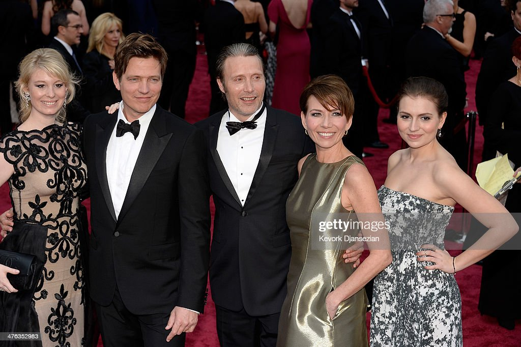 Actress Helene Reingaard Neumann, Director Thomas Vinterberg, actor Mads Mikkelsen and guests attend the Oscars held at Hollywood & Highland Center on March 2, 2014 in Hollywood, California.