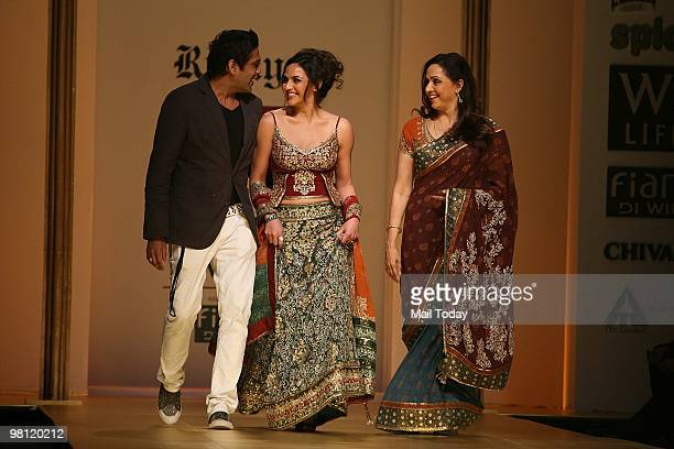 Actress Hema Malini with daughter Esha Deol and designer Rocky S walks the ramp at day three of the Wills Lifestyle India Fashion Week Autumn Winter...