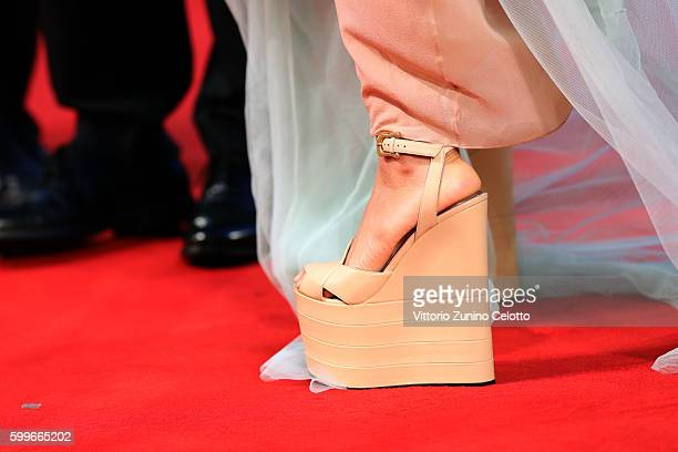 Actress Hikari Mitsushima shoes detail attends the premiere of 'The Bad Batch' during the 73rd Venice Film Festival at Sala Grande on September 6...