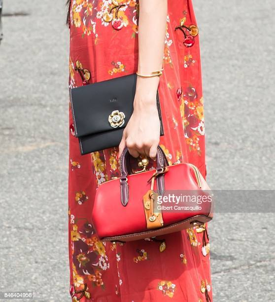 Actress Hikari Mori handbag detail is seen arriving to Coach Spring 2018 fashion show during New York Fashion Week at Basketball City Pier 36 South...
