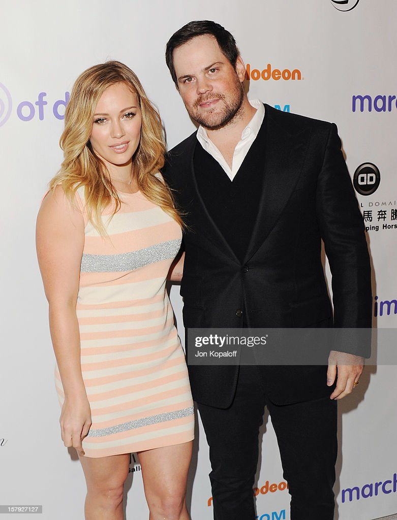 Actress Hilary Duff and husband Mike Comrie arrive at the March Of Dimes Celebration Of Babies Luncheon at Beverly Hills Hotel on December 7, 2012 in Beverly Hills, California.