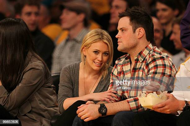 Actress Hilary Duff and Mike Comrie of the Edmonton Oilers watch the Los Angeles Lakers play the Phoenix Suns in Game One of the Western Conference...