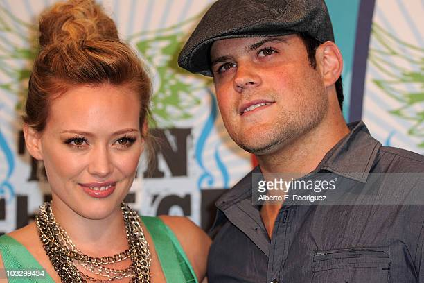 Actress Hilary Duff and NHL player Mike Comrie pose in the press room at the 2010 Teen Choice Awards held at the Gibson Amphitheatre on August 8 2010...