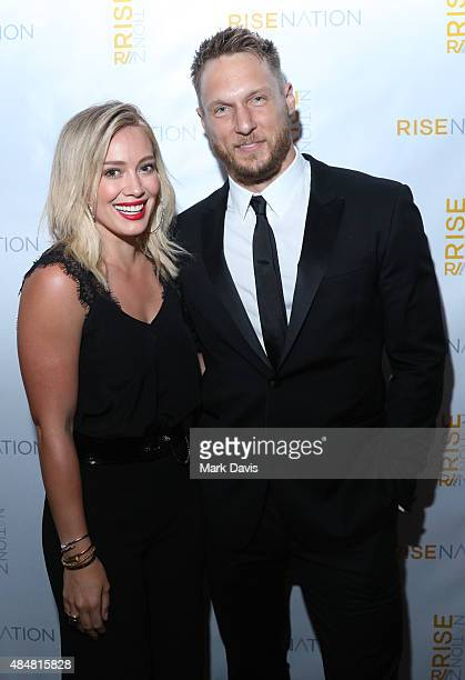 Actress Hilary Duff and personal/celebrity trainer Jason Walsh attend 'Rise Nation Fitness Studio's Los Angeles Grand Opening' on August 21 2015 in...