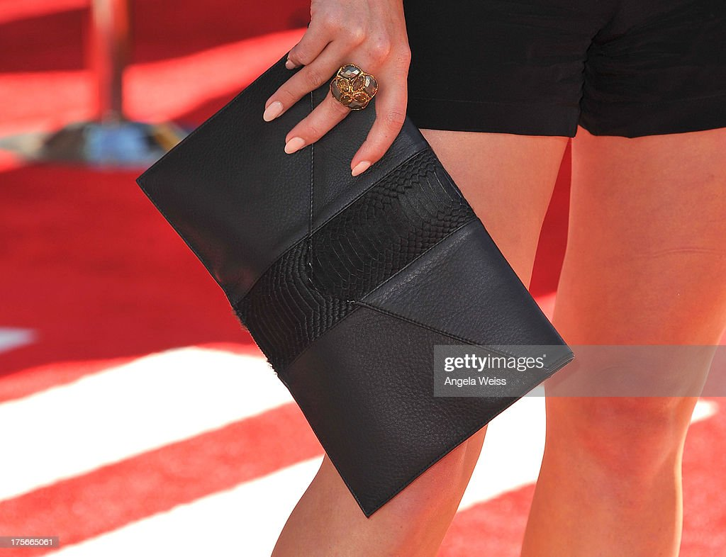 Actress Hilary Duff (purse detail) arrives at the premiere of Disney's 'Planes' presented by Target at the El Capitan Theatre on August 5, 2013 in Hollywood, California.