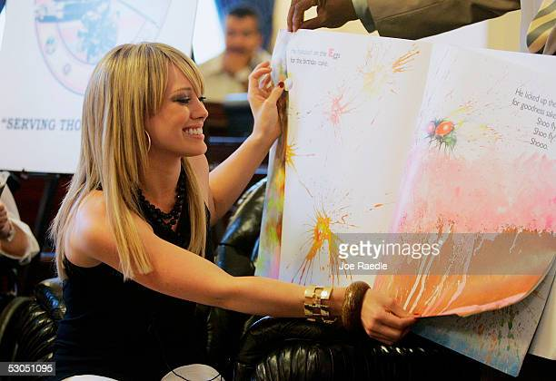 Actress Hilary Duff reads a book to children during a visit to Capitol Hill to promote National Military Families Week June 10 2005 in Washington DC