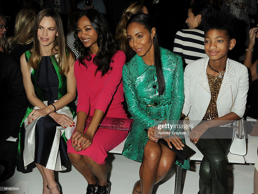 Actress Hilary Swank, Actress Zoe Saldana, Actress Jada Pinkett Smith and daughter Willow Smith front row during the Michael Kors Fall 2013 Mercedes-Benz Fashion Show at The Theater at Lincoln Center on February 13, 2013 in New York City.