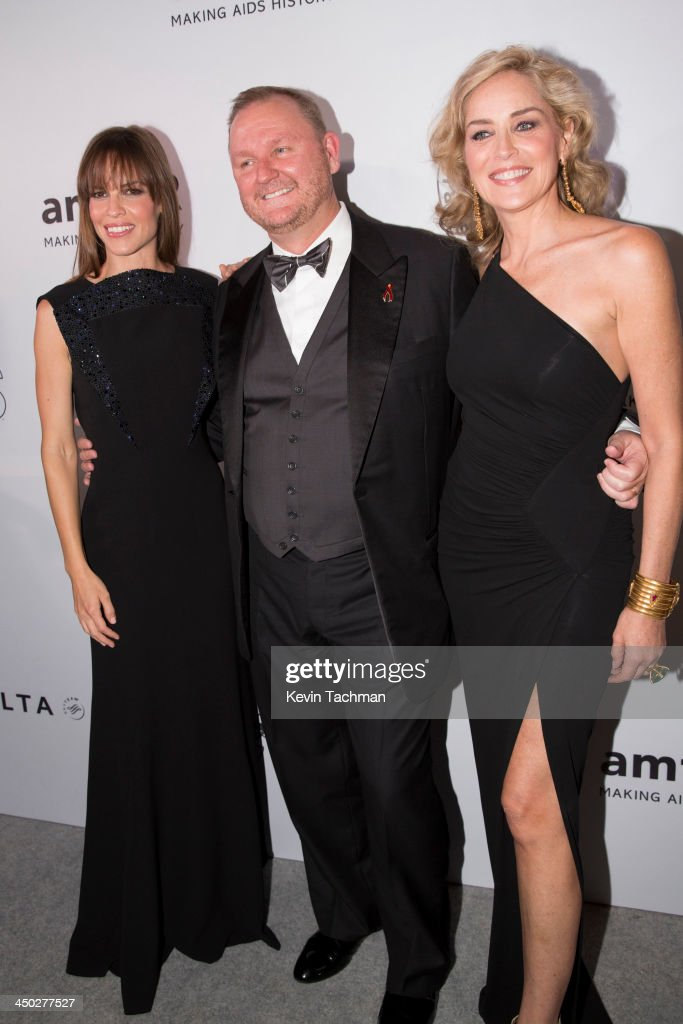 Actress <a gi-track='captionPersonalityLinkClicked' href=/galleries/search?phrase=Hilary+Swank&family=editorial&specificpeople=201692 ng-click='$event.stopPropagation()'>Hilary Swank</a>, Amfar Chaiman of the Board Kevin Robert Frost and actress <a gi-track='captionPersonalityLinkClicked' href=/galleries/search?phrase=Sharon+Stone&family=editorial&specificpeople=156409 ng-click='$event.stopPropagation()'>Sharon Stone</a> attend the inaugural amfAR India event at the Taj Mahal Palace Mumbai on November 17, 2013 in Mumbai, India.