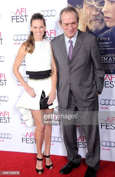 Actress Hilary Swank and actor Tommy Lee Jones arrive at The Homesman' premiere during AFI FEST 2014 Presented By Audi held at Dolby Theatre on...