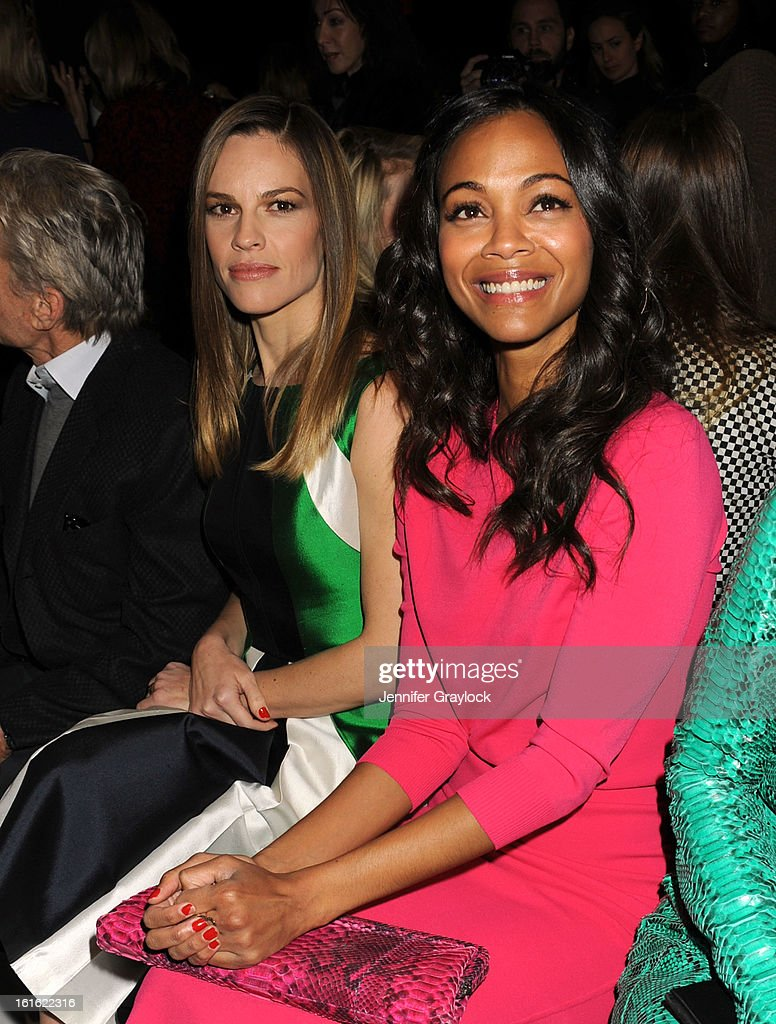 Actress Hilary Swank and Actress Zoe Saldana front row during the Michael Kors Fall 2013 Mercedes-Benz Fashion Show at The Theater at Lincoln Center on February 13, 2013 in New York City.