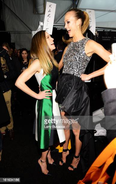 Actress Hilary Swank and model Karlie Kloss pose backstage at the Michael Kors Fall 2013 fashion show during MercedesBenz Fashion Week at The Theatre...