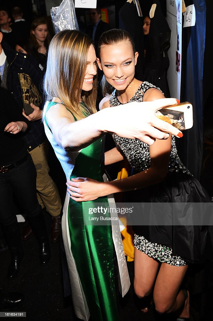 Actress Hilary Swank and model Karlie Kloss pose backstage at the Michael Kors Fall 2013 fashion show during Mercedes-Benz Fashion Week at The Theatre at Lincoln Center on February 13, 2013 in New York City.