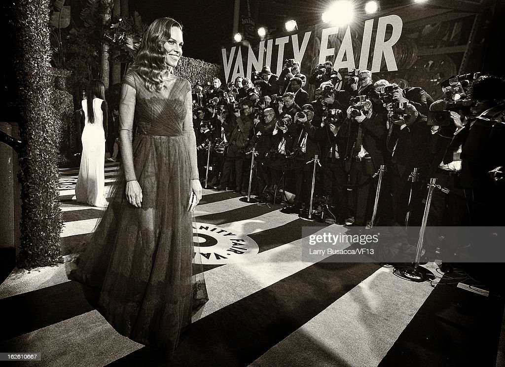 Actress <a gi-track='captionPersonalityLinkClicked' href=/galleries/search?phrase=Hilary+Swank&family=editorial&specificpeople=201692 ng-click='$event.stopPropagation()'>Hilary Swank</a> arrives for the 2013 Vanity Fair Oscar Party hosted by Graydon Carter at Sunset Tower on February 24, 2013 in West Hollywood, California.