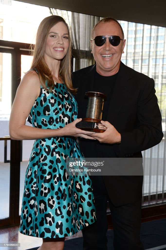 Actress <a gi-track='captionPersonalityLinkClicked' href=/galleries/search?phrase=Hilary+Swank&family=editorial&specificpeople=201692 ng-click='$event.stopPropagation()'>Hilary Swank</a> (L) poses with designer <a gi-track='captionPersonalityLinkClicked' href=/galleries/search?phrase=Michael+Kors+-+Fashion+Designer&family=editorial&specificpeople=4289231 ng-click='$event.stopPropagation()'>Michael Kors</a> at The Couture Council of The Museum at the Fashion Institute of Technology hosted luncheon honoring <a gi-track='captionPersonalityLinkClicked' href=/galleries/search?phrase=Michael+Kors+-+Fashion+Designer&family=editorial&specificpeople=4289231 ng-click='$event.stopPropagation()'>Michael Kors</a> with the 2013 Couture Council Award on September 4, 2013 in New York City.