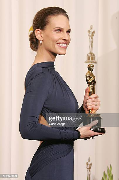 Actress Hilary Swank poses with her award for Best Actress for 'Million Dollar Baby' backstage during the 77th Annual Academy Awards on February 27...