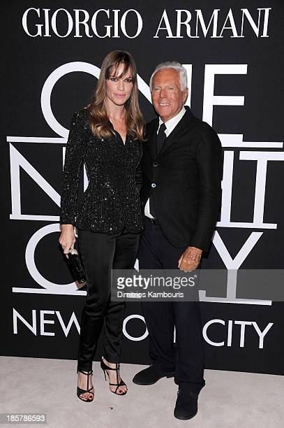 Actress Hilary Swank wearing Armani and fashion designer Giorgio Armani attend Giorgio Armani One Night Only NYC at SuperPier on October 24 2013 in...