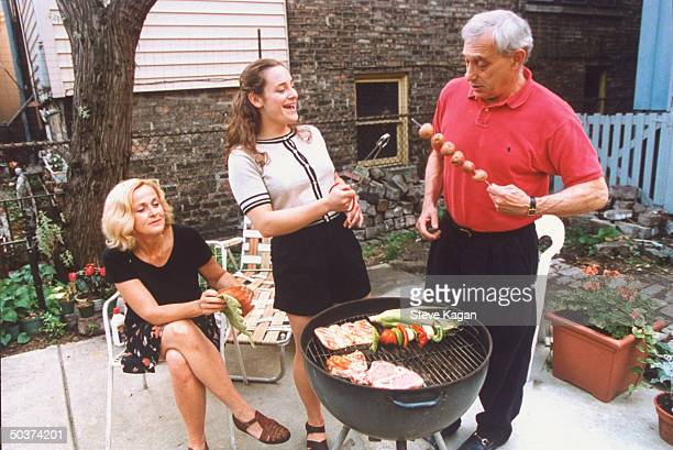 Actress Hillary Wolf who is a member of the 1996 US Olympic women's judo team barbecuing w divorced parents Malcolm Marilyn in backyard of Marilyn's...