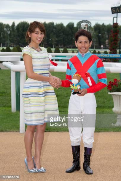 Actress Hisamatsu Ikumi and jockey Keita Tosaki celebrate after Blanc Bonheur winning the Race 11 Keeneland Cup at the Sapporo Racecourse on August...