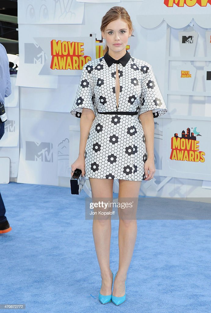 Actress Holland Roden arrives at the 2015 MTV Movie Awards at Nokia Theatre LA Live on April 12 2015 in Los Angeles California
