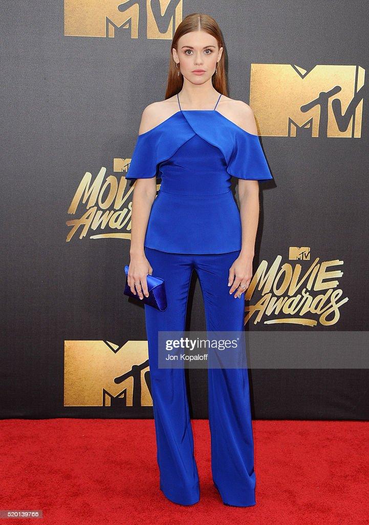 Actress Holland Roden arrives at the 2016 MTV Movie Awards at Warner Bros Studios on April 9 2016 in Burbank California