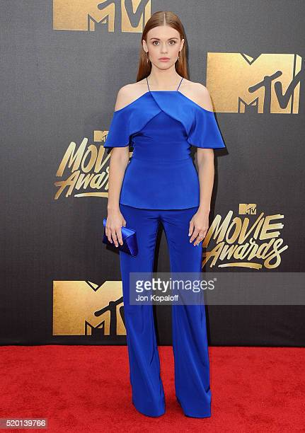 Actress Holland Roden arrives at the 2016 MTV Movie Awards at Warner Bros Studios on April 9 2016 in Burbank California