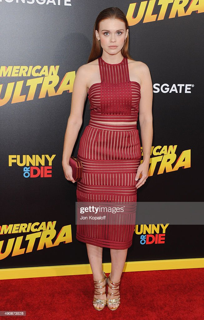 Actress Holland Roden arrives at the Los Angeles Premiere 'American Ultra' at Ace Theater Downtown LA on August 18 2015 in Los Angeles California