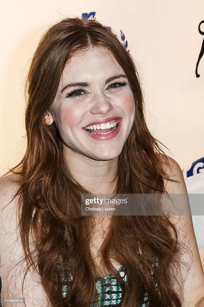 Actress <a gi-track='captionPersonalityLinkClicked' href=/galleries/search?phrase=Holland+Roden&family=editorial&specificpeople=5578822 ng-click='$event.stopPropagation()'>Holland Roden</a> attends MTV2 Party in The Park at Comic-con International 2013 at PETCO Park on July 18, 2013 in San Diego, California.