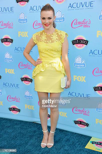 Actress Holland Roden attends the 2013 Teen Choice Awards at Gibson Amphitheatre on August 11 2013 in Universal City California