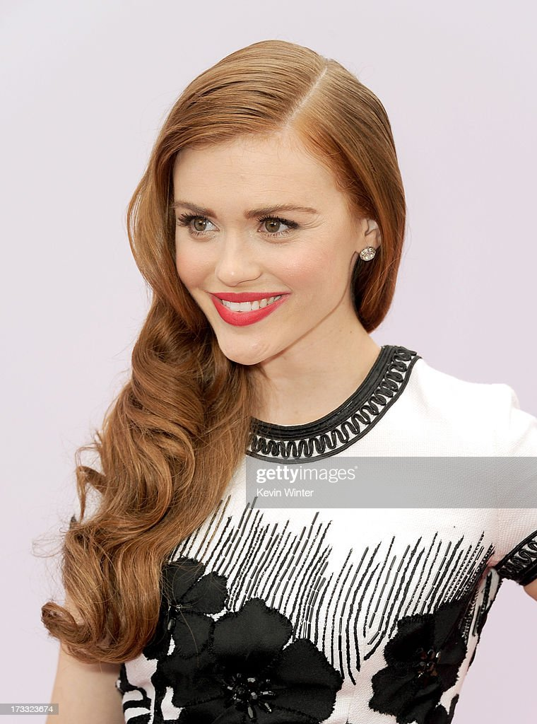 Actress Holland Roden attends the premiere of Summit Entertainment's 'RED 2' at Westwood Village on July 11, 2013 in Los Angeles, California.