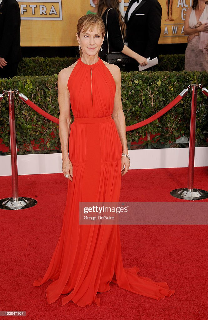 Actress <a gi-track='captionPersonalityLinkClicked' href=/galleries/search?phrase=Holly+Hunter&family=editorial&specificpeople=201880 ng-click='$event.stopPropagation()'>Holly Hunter</a> arrives at the 20th Annual Screen Actors Guild Awards at The Shrine Auditorium on January 18, 2014 in Los Angeles, California.