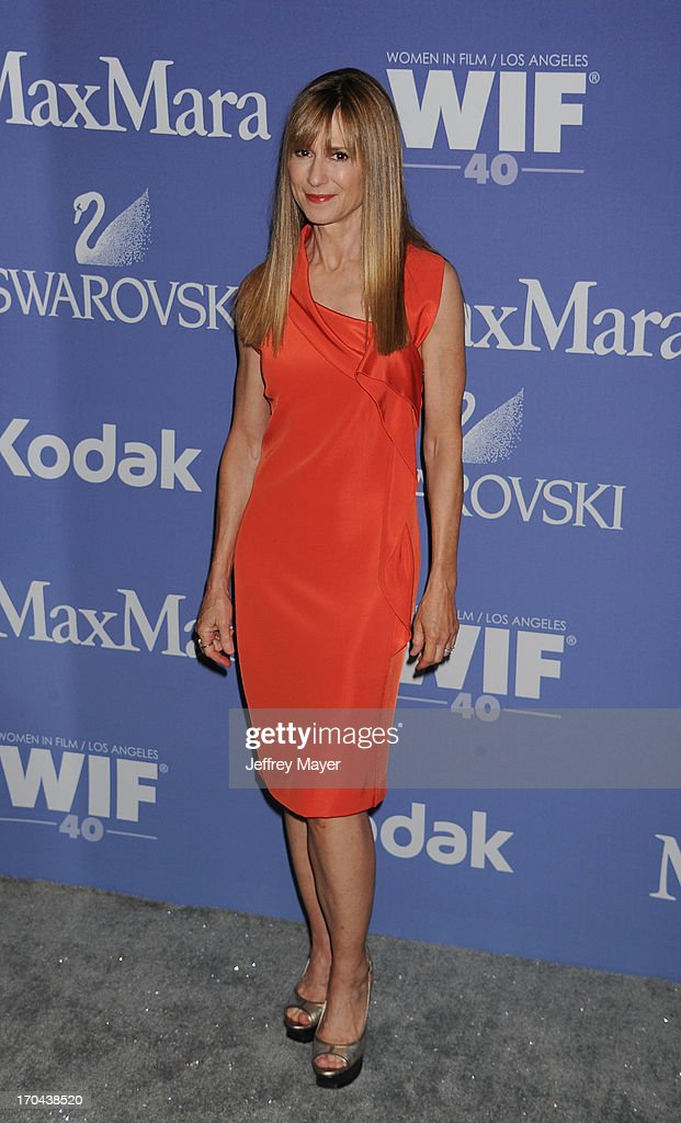 Actress <a gi-track='captionPersonalityLinkClicked' href=/galleries/search?phrase=Holly+Hunter&family=editorial&specificpeople=201880 ng-click='$event.stopPropagation()'>Holly Hunter</a> attends Women In Film's 2013 Crystal + Lucy Awards at The Beverly Hilton Hotel on June 12, 2013 in Beverly Hills, California.