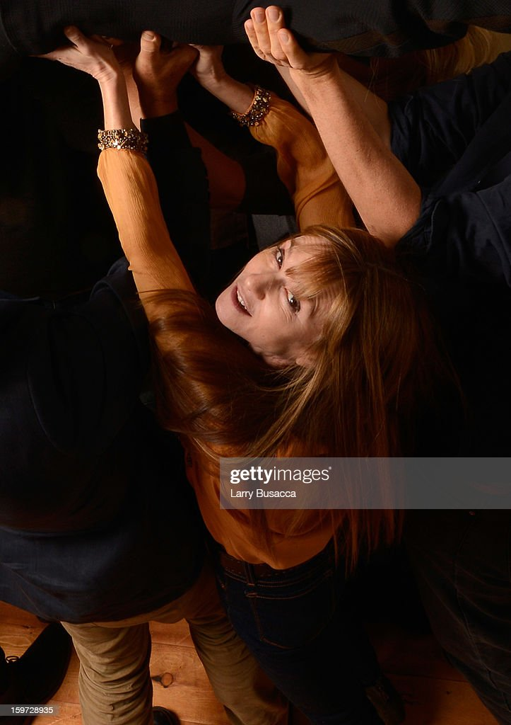 Actress <a gi-track='captionPersonalityLinkClicked' href=/galleries/search?phrase=Holly+Hunter&family=editorial&specificpeople=201880 ng-click='$event.stopPropagation()'>Holly Hunter</a> poses for a portrait during the 2013 Sundance Film Festival at the Getty Images Portrait Studio at Village at the Lift on January 19, 2013 in Park City, Utah.