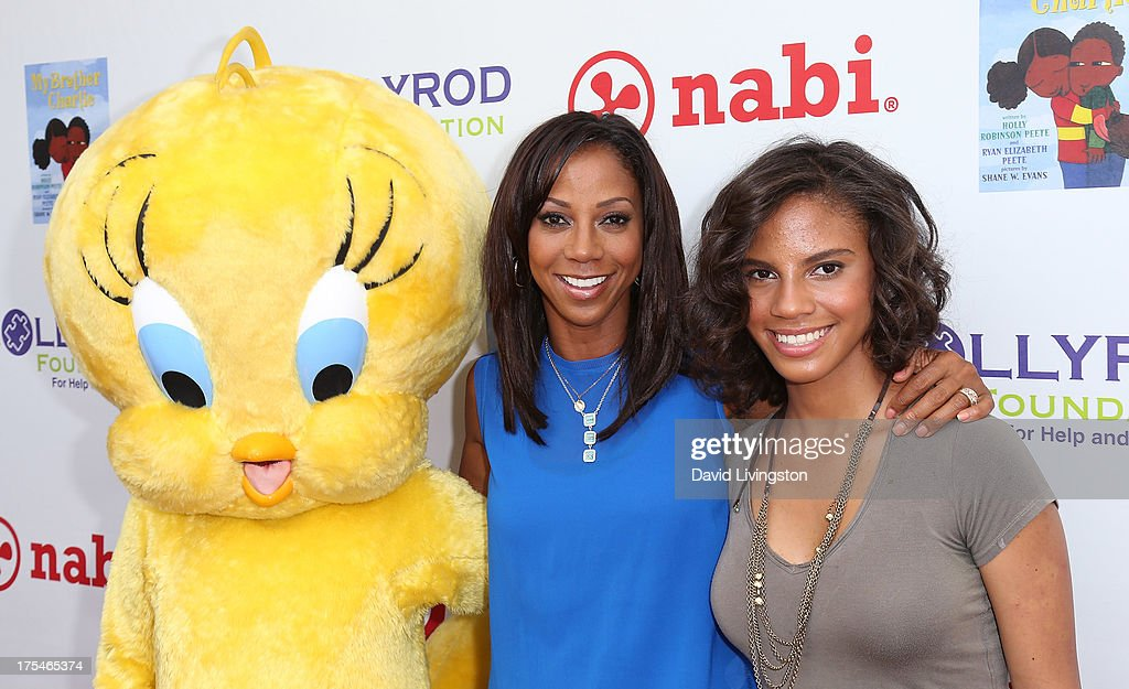 Actress <a gi-track='captionPersonalityLinkClicked' href=/galleries/search?phrase=Holly+Robinson+Peete&family=editorial&specificpeople=213716 ng-click='$event.stopPropagation()'>Holly Robinson Peete</a> (L) and daughter Ryan Elizabeth Peete attend the HollyRod Foundation's 4th Annual My Brother Charlie Carnival at Culver Studios on August 3, 2013 in Culver City, California.