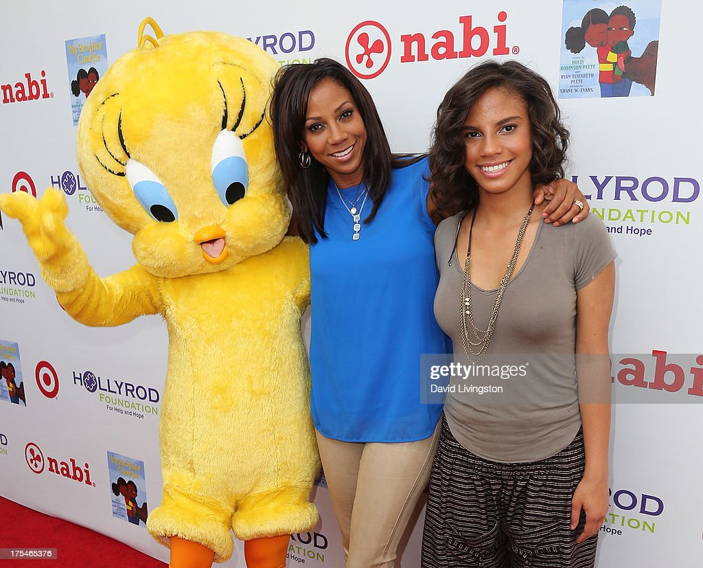 Actress Holly Robinson Peete (L) and daughter Ryan Elizabeth Peete attend the HollyRod Foundation's 4th Annual My Brother Charlie Carnival at Culver Studios on August 3, 2013 in Culver City, California.