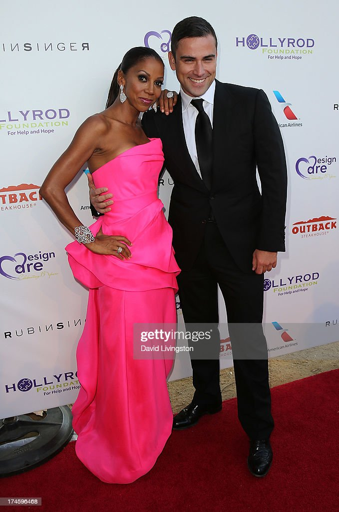 Actress <a gi-track='captionPersonalityLinkClicked' href=/galleries/search?phrase=Holly+Robinson+Peete&family=editorial&specificpeople=213716 ng-click='$event.stopPropagation()'>Holly Robinson Peete</a> (L) and designer Rubin Singer attend the 15th Annual DesignCare on July 27, 2013 in Malibu, California.