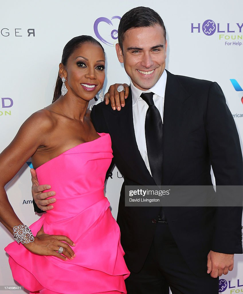 Actress Holly Robinson Peete (L) and designer Rubin Singer attend the 15th Annual DesignCare on July 27, 2013 in Malibu, California.
