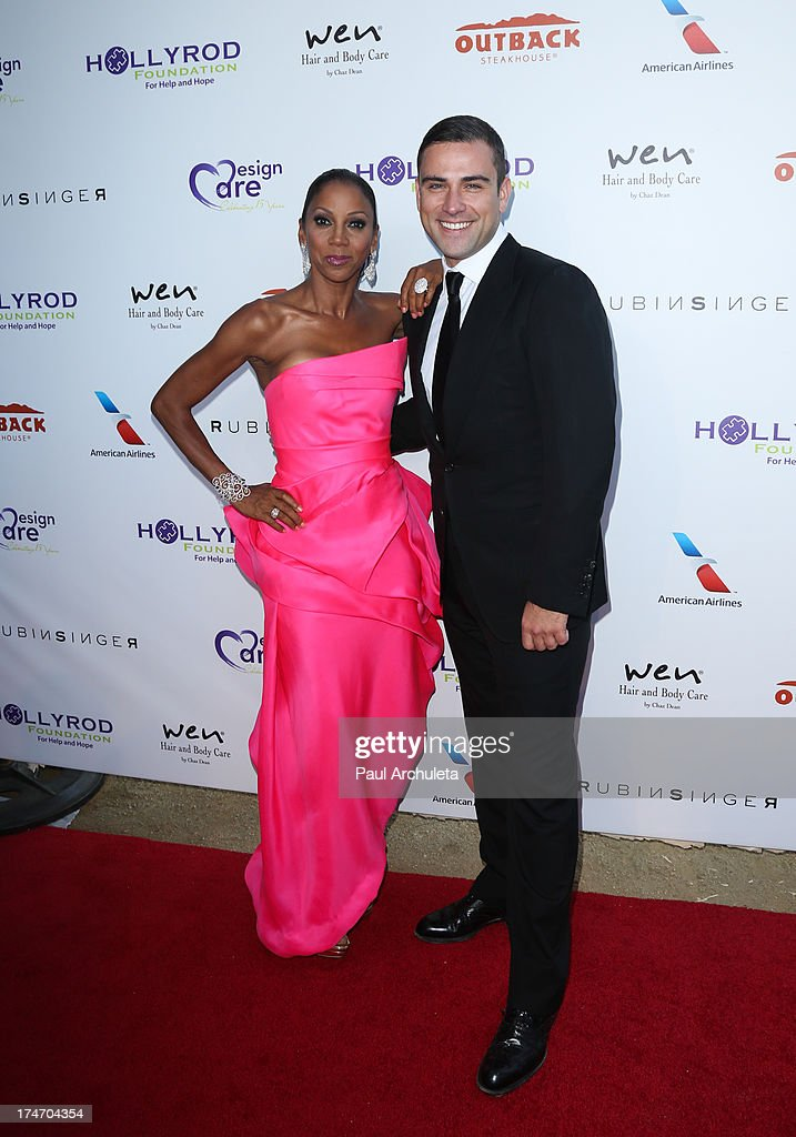 Actress Holly Robinson Peete (L) and Fashion Designer Rubin Singer (R) attend the 15th annual DesignCare charity event on July 27, 2013 in Malibu, California.